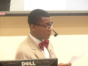 Moderator Brandon Harris reads a question submitted by the audience