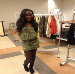 Simone Wright, host of The Empress' New Clothes event, models an army fatigue dress she created from a t-shirt. Photo by: Dominique Youngblood
